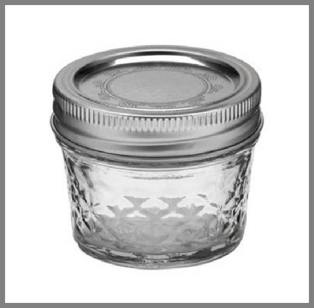 Little glass jars with lids image